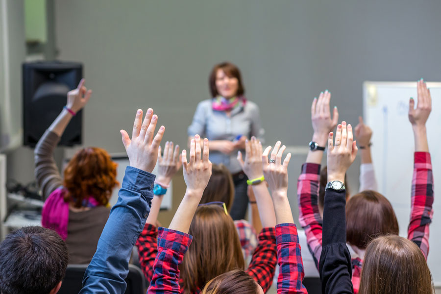 Hands up in classroom