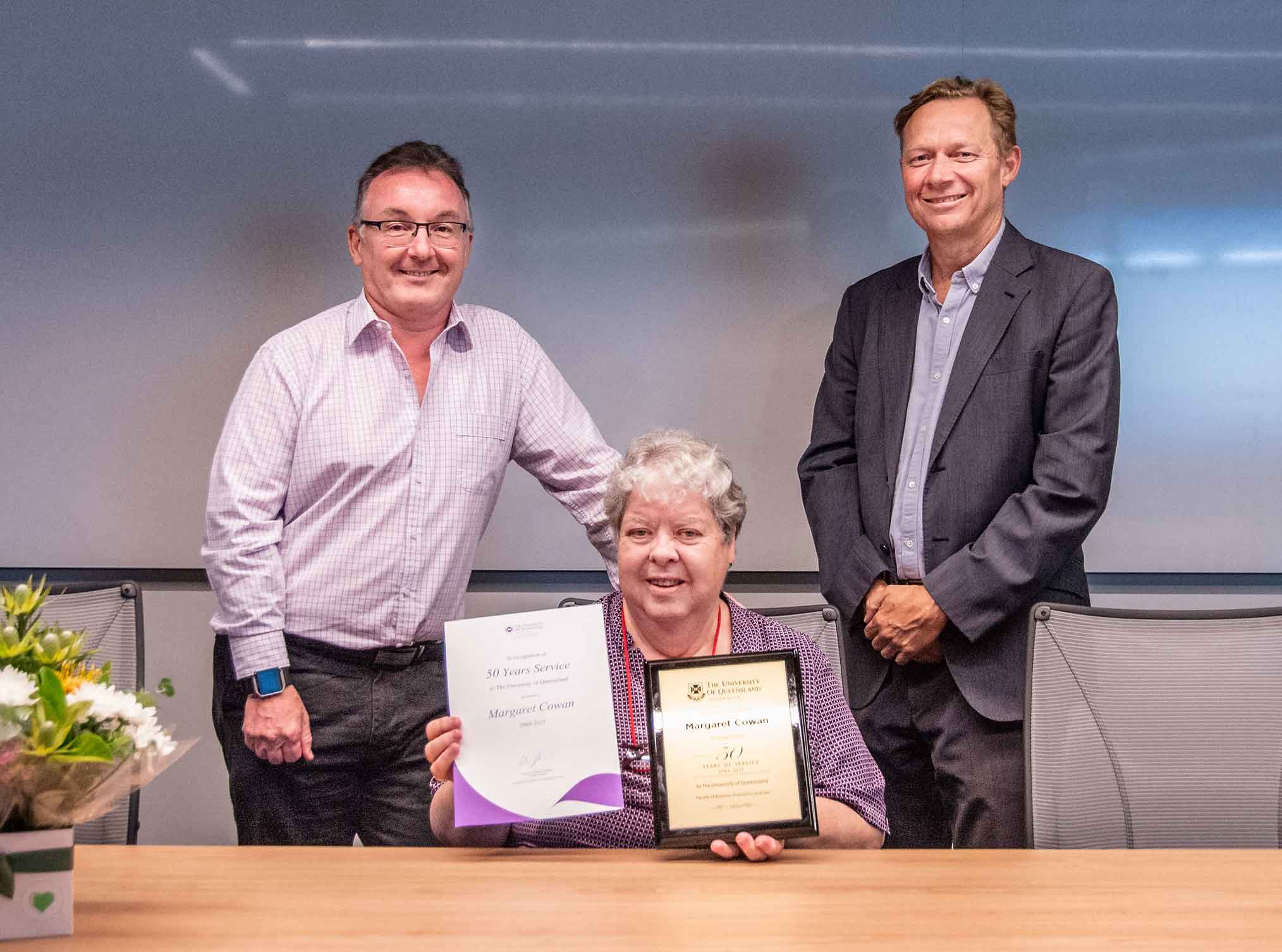 This is an image of Deputy Executive Dean Phil Bodman, award-winner Margaret Cowan, and Executive Dean Professor Andrew Griffiths