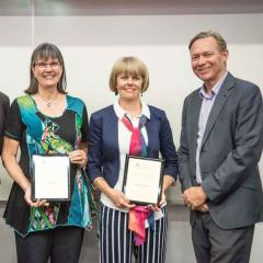 This is a photo of two BEL research award-winners with Professor Andrew Griffiths