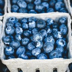 This is an image of several cartons of blueberries