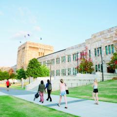 This is an image of students walking past UQ's Forgan Smith building