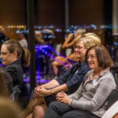 women listening to speaker at Women in Law night, 2019