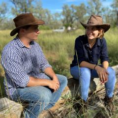 Briana Collins with EDO principal solicitor Sean Ryan in the footprint of the proposed Galilee Coal Project mine