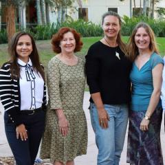 This is an image of two new PhD candidates and Ecotourism Australia scholarship recipients with their advisors