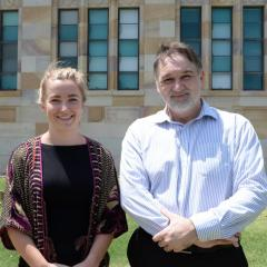 This is an image of Dr Miriam Yates and Dr Terry Fitzsimmons standing outside the Forgan Smith building