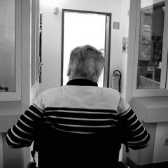 aged man in wheelchair in care facility