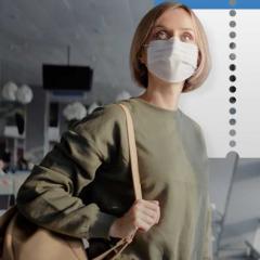 woman wearing medical mask at airport