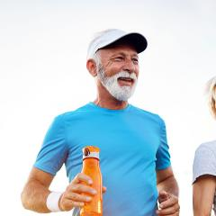This is an image of an older man and woman exercising