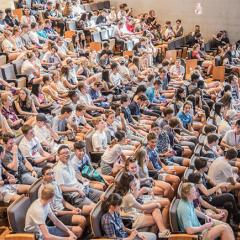 a packed lecture theatre full of students at UQ.