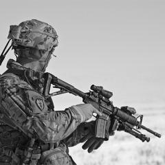 Black and white picture of American soldier looking into the distance.