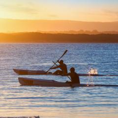 Two kayakers paddling in Noosa, Queensland