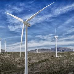 wind farm on a rolling empty plain