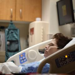 woman resting in hospital bed