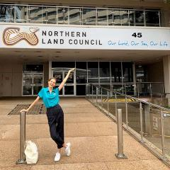 Anna Kretowicz smiling in front of the Northern Land Council building in Darwin