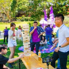 BEL students in the UQ Natural Ampitheatre playing Jenga