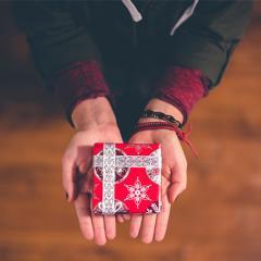 Hands giving present