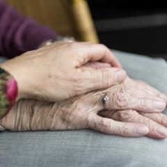 This is an image of the hands of two elderly people