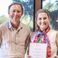 Professor Andrew Griffiths (left) with Associate Professor Gabby Walters (right) and her award