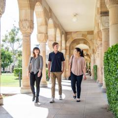 Three Frank Finn Scholarship recipients walking through the Great Court