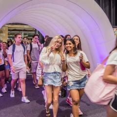 Students entering the BELfest event via a purple lit up tunnel